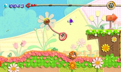 Kirby's Extra Epic Yarn 3DS Screenshot Smiling Kirby Swinging Around